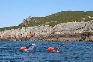 Two-swimmers-swimming-around-Cabo-Espich