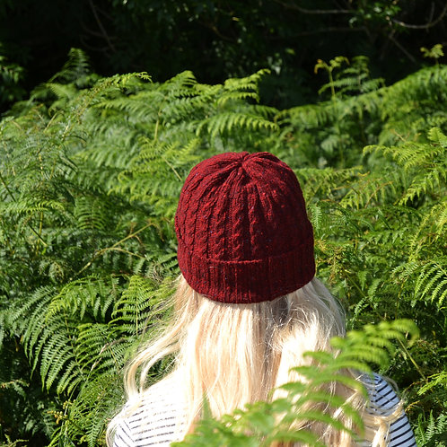 Red Donegal unisex beanie hat with cable knit pattern