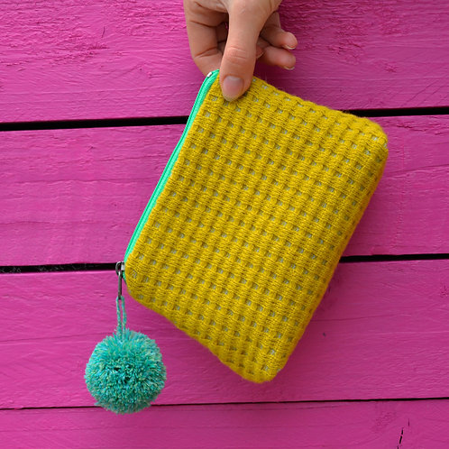 Yellow purse with mint green zipper and pom pom