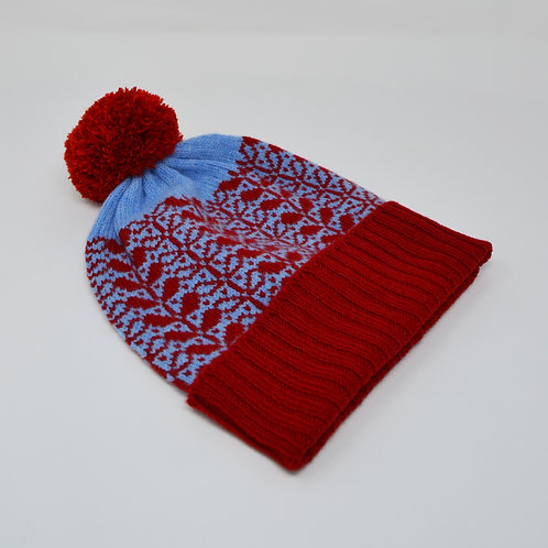 Blue, red  pom pom hat with flora pattern
