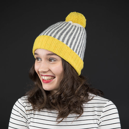 Yellow, white and grey hat with yellow pom pom