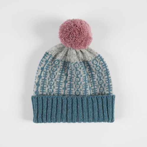 Blue and grey hat with pink pom pom