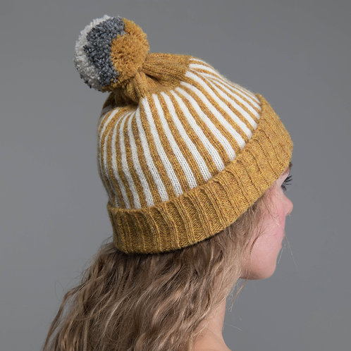 Mustard yellow hat with white stripes and pom pom