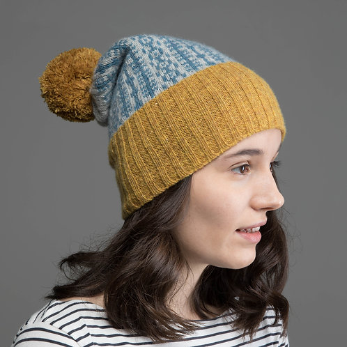 Mustard yellow, blue and grey hat with yellow pom pom