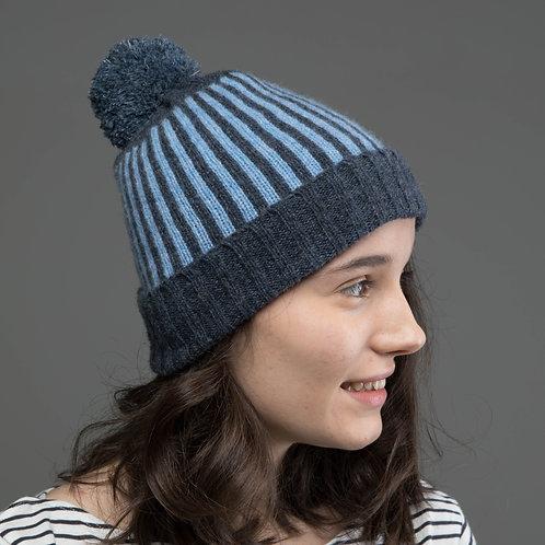 Dark grey, blue hat with pom pom