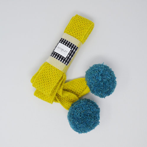 Yellow skinny scarf with blue pom poms