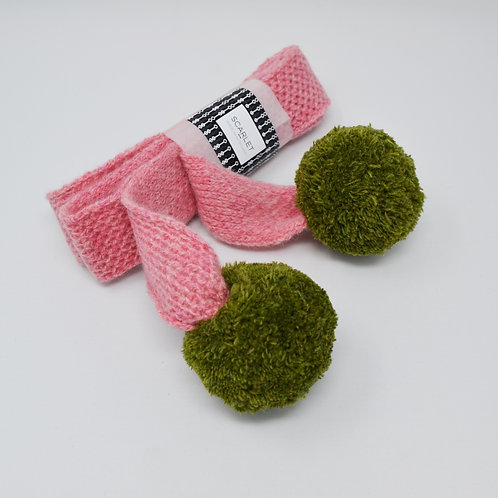 Pink skinny scarf with green pom poms