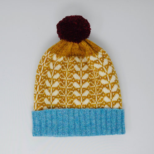 Mustard/white hat with blue rib and flora pattern