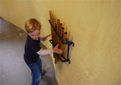 Child playing chimes