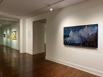 a-room-with-paintings-on-the-wall-descri