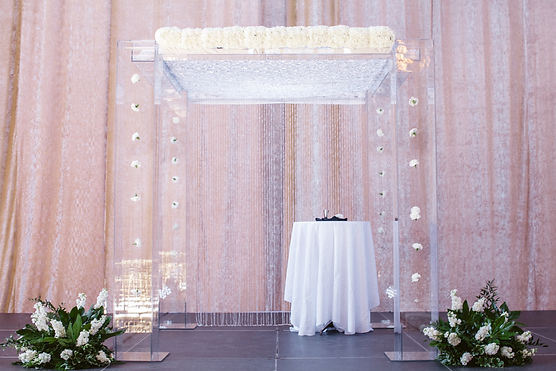 Chuppah decoration and flowers by Eden Floral and Design, Photo by LRG Photography at LRGphoto.net