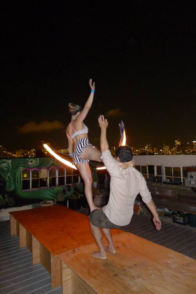 Performing acro with fire