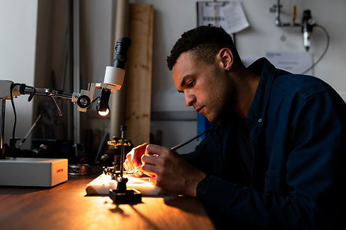 AN image of an engineer working in his workshop.