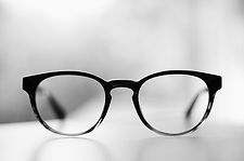 An image of a pair of reading glasses.
