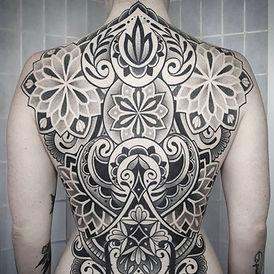 Ornamental blackwork backpiece tattoo by Siarn Engels