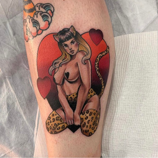 Kitty pinup tattoo by Sophie Lewis