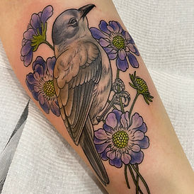 Bird and flower tattoo by Jade Lomax