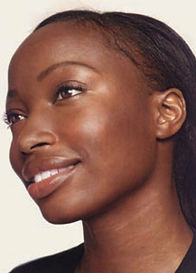 A young black woman wih even, clear skin