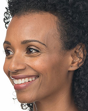 Black woman's face with visible crow's feet around her eyes