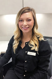 Aesthetician Morgan Pohlman sits in an office chair