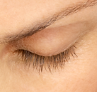 Close-up of a woman's eye with fuller lashes