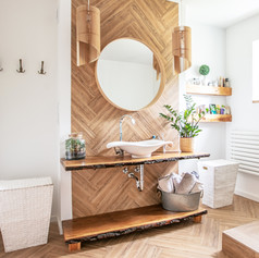 White sink on wood counter with a round