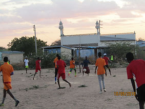 Kenyan children playing in front of Mosque