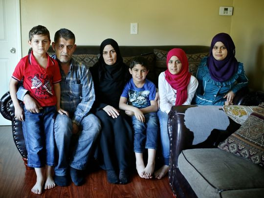 (From left) Mohmmod Assad, 8; Moustafa Assad, 48; Wafa Al Ahmad, 39; Liath Assad, 10; Shihd Assad, 14, and Riasha Assad, 19, are photographed in their home on Tuesday, Sept. 22, 2015, in Garden City. Originally from Idlib, Syria, the family fled to Istanbul, Turkey, because of the war and bombing there made it difficult to live in peace. (Photo: Salwan Georges, Detroit Free Press)