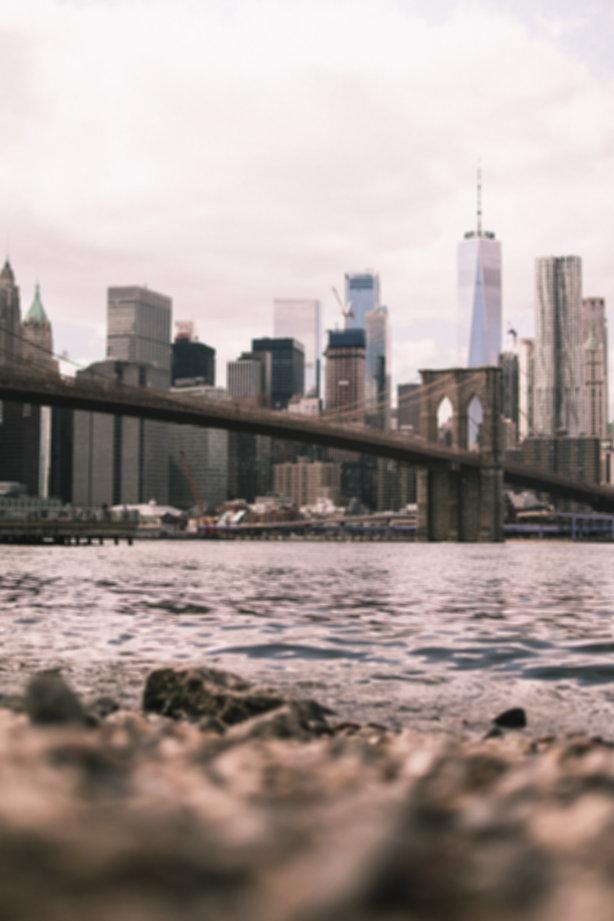 gray-concrete-bridge-over-body-of-water-