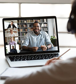 Professionals talking and connecting with each other over the laptop