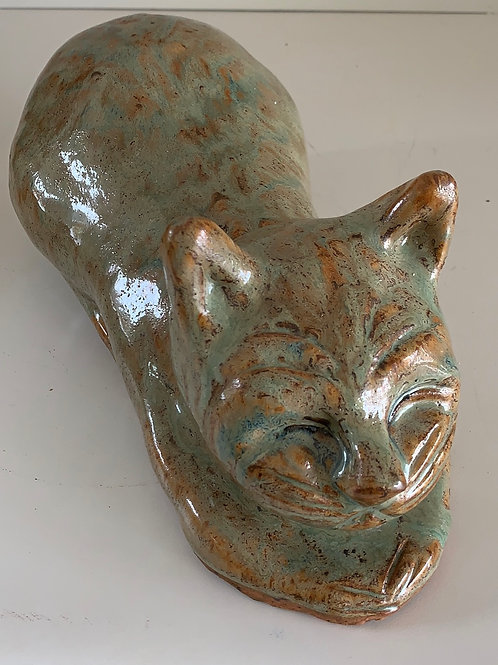teal and brown pottery cat, lying cat, porch cat