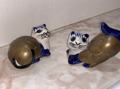 Brass over ceramic cats; mexican brass cats