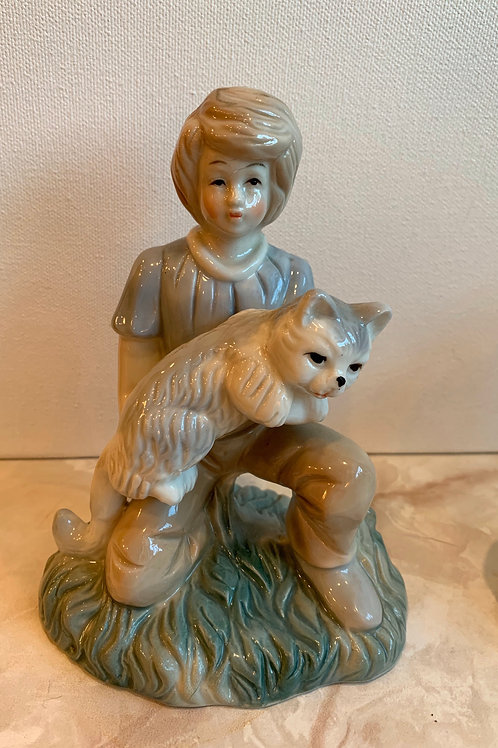 boy with cat; kneeling boy holds cat