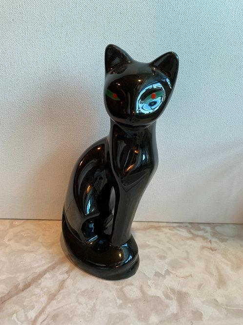 spooky cat; black watching cat; mantel cat