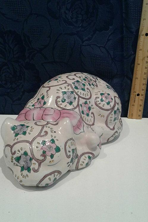 floral cat, napping; ceramic cat;