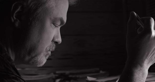 Thomas-Writing-in-Room.jpg