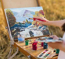 young-artist-hand-painting-nature_23-214