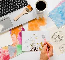 artist-painting-tools-desk_23-2148575593