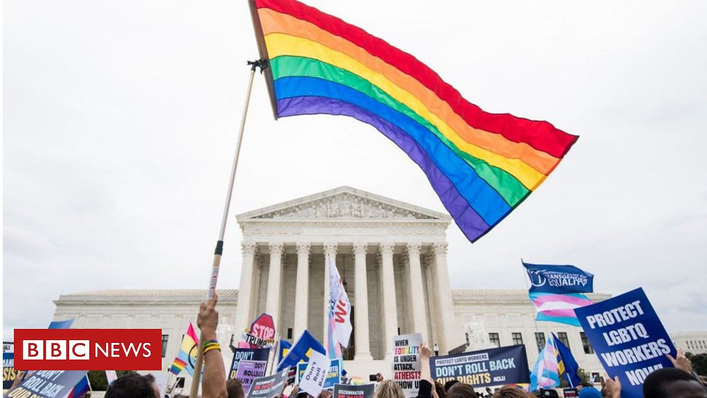 While the Supreme Court convenes inside to discuss if sexuality and gender identity are protected from employment discrimination, a rally forms outside. (Image Source: Bill Clark/CQ-Roll Call, Inc/Getty Images)      < Return to LGBT History Employment Discrimination
