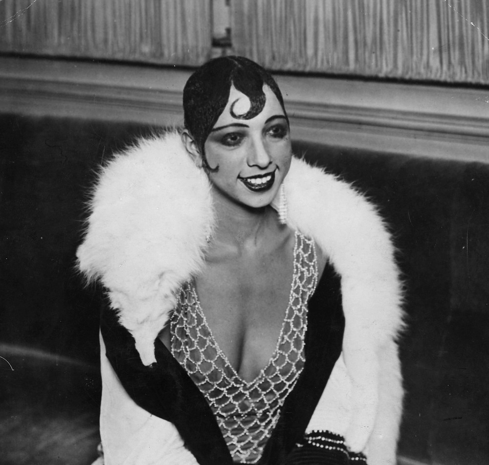 A portrait of Josephine Baker in one of her extravagant performance looks. Baker was known for her unique style both in terms of looks and dance. (Image Source: General Photographic Agency/Getty Images)