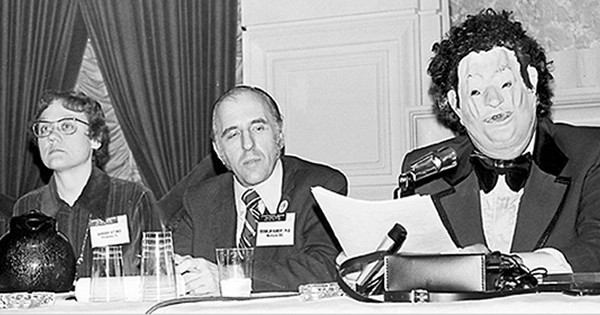 Dr. John Fryer giving his speech as Dr. Henry Anonymous to convince the APA to declassify homosexuality as a mental illness at the 1972 APA annual conference (Image Source: 217 Boxes of Dr. Henry Anonymous/Ain Gordan)