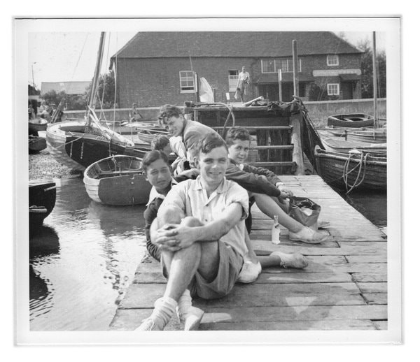 A picture taken of Alan Turing, Fred Clayton (another student of King's College), and two refugee boys from Austria, Robert and Karl. This very image was used by the GCHQ to apologize for their actions against Turing. (Image Credit: Susannah Ireland)