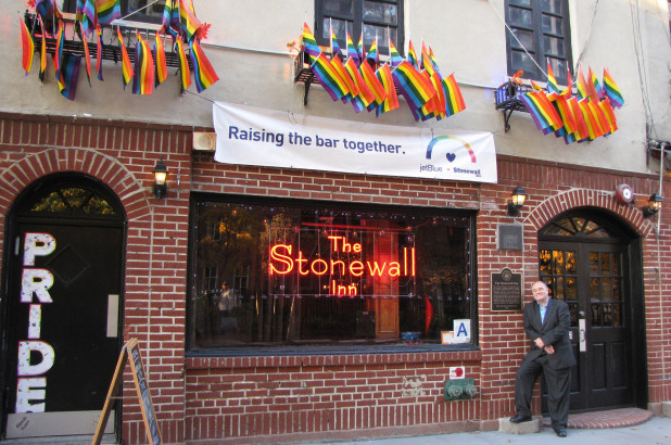 Stonewall Riots veteran Mark Segal in front of The Stonewall Inn as it appears today (Image Source: The Smithsonian Channel)
