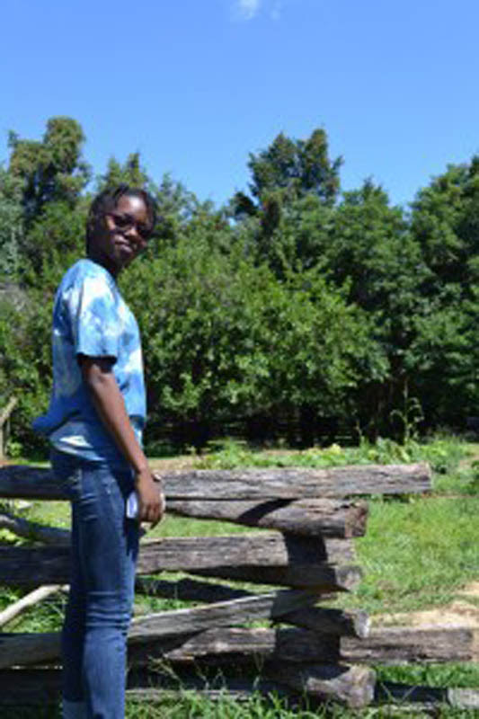 Tyler Reid, 15, shares her experiences on the farm. (photo by Anjela Barnes, Accokeek Foundation)
