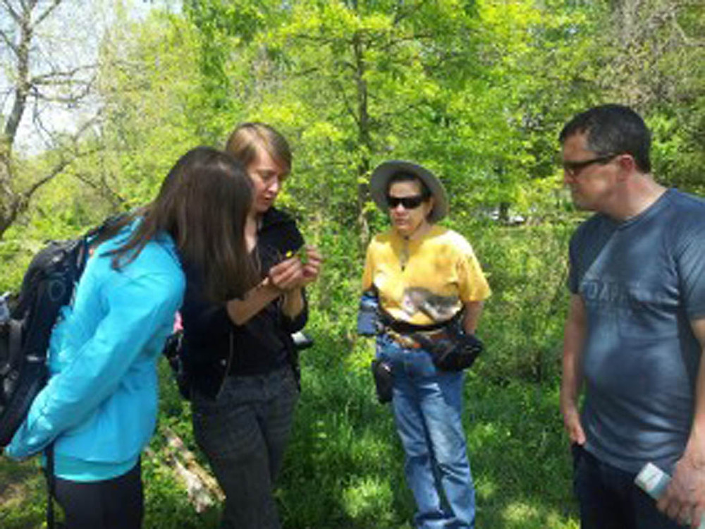 Inspecting Buttercup during April's Plant ID Walk