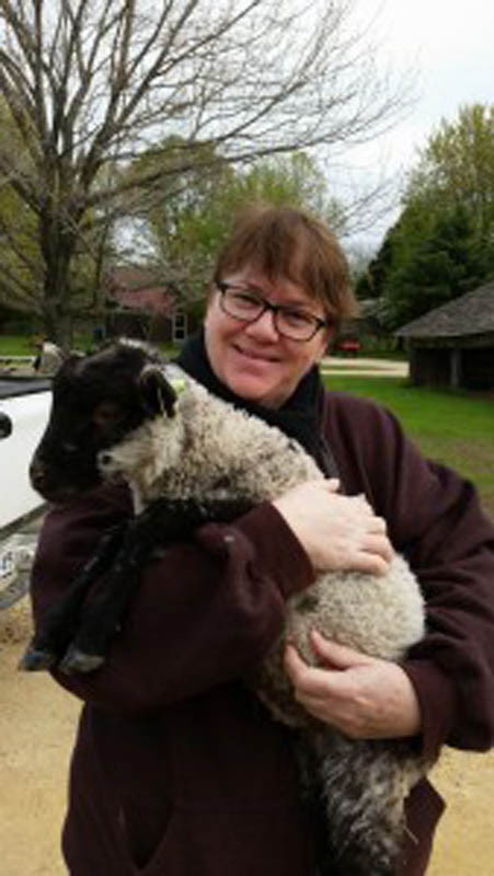 Terrie-Lea poses with Hog Island lamb, Nigel.