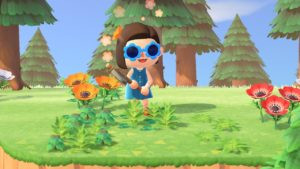 "Screenshot from Animal Crossing. The author's character stands holding an axe surrounded by flowers and spring ""weeds"""