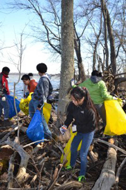 Volunteers help to remove debris from the Potomac shoreline at Piscataway Park during the annual Potomac River Clean-up.