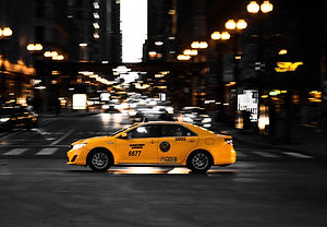 photography-of-yellow-taxi-on-road-12367