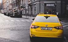 yellow-taxi-vehicle-near-gray-concrete-b